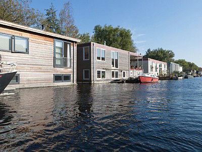 Case galleggianti sul fiume Amstel